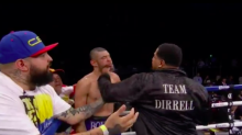 Watch: Boxer's uncle sucker-punches opponent after match
