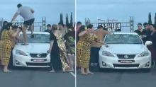 'Disturbing' road rage attack sees 12 people 'smash Lexus'