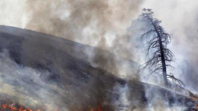 Fire season drags on in West