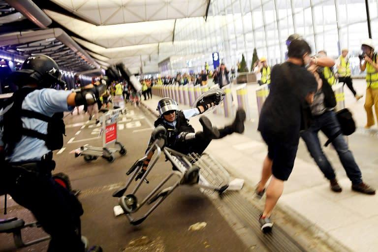Protests at Hong Kong airport last week descended into violence (AFP Photo/Manan VATSYAYANA)