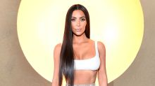 Kim Kardashian stuns in high-slit sheer mesh skirt at Balmain party