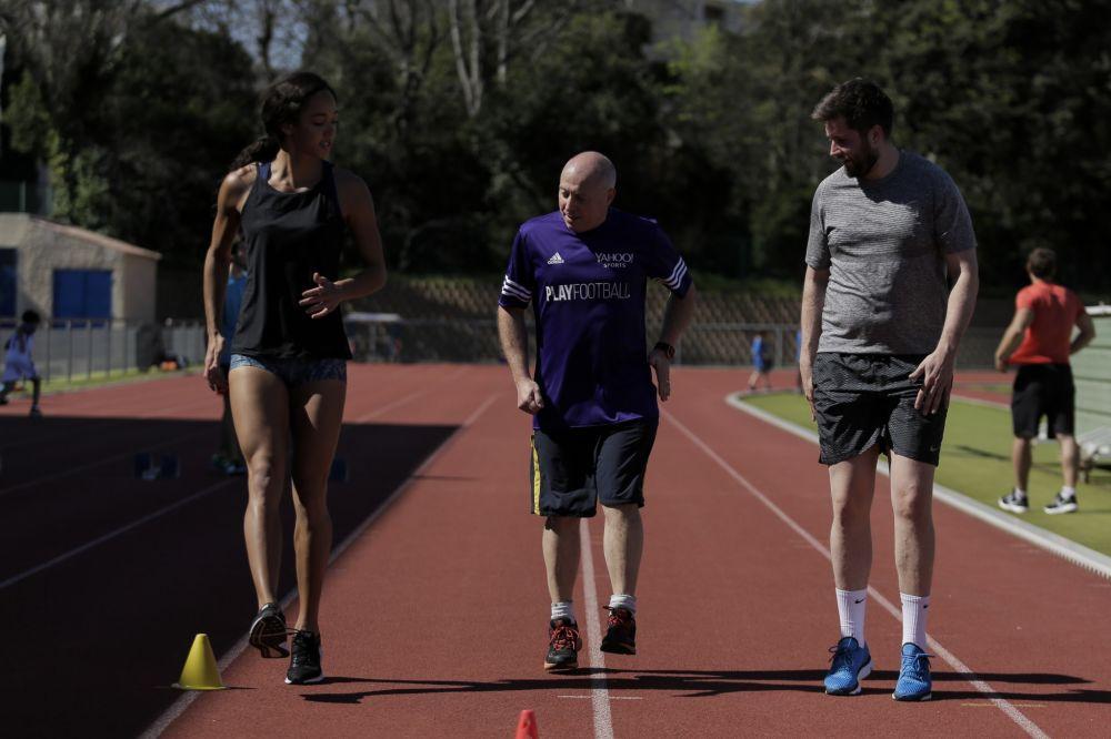 Katarina Johnson-Thompson puts Mark Lawford (centre) through his paces