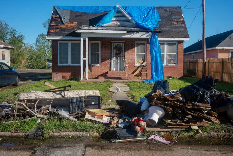 Debris and tarps are tossed around after Hurricane Delta in Lake Charles