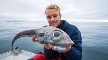 Fisherman gets shock as he reels in 'dinosaur-like' fish with huge eyes