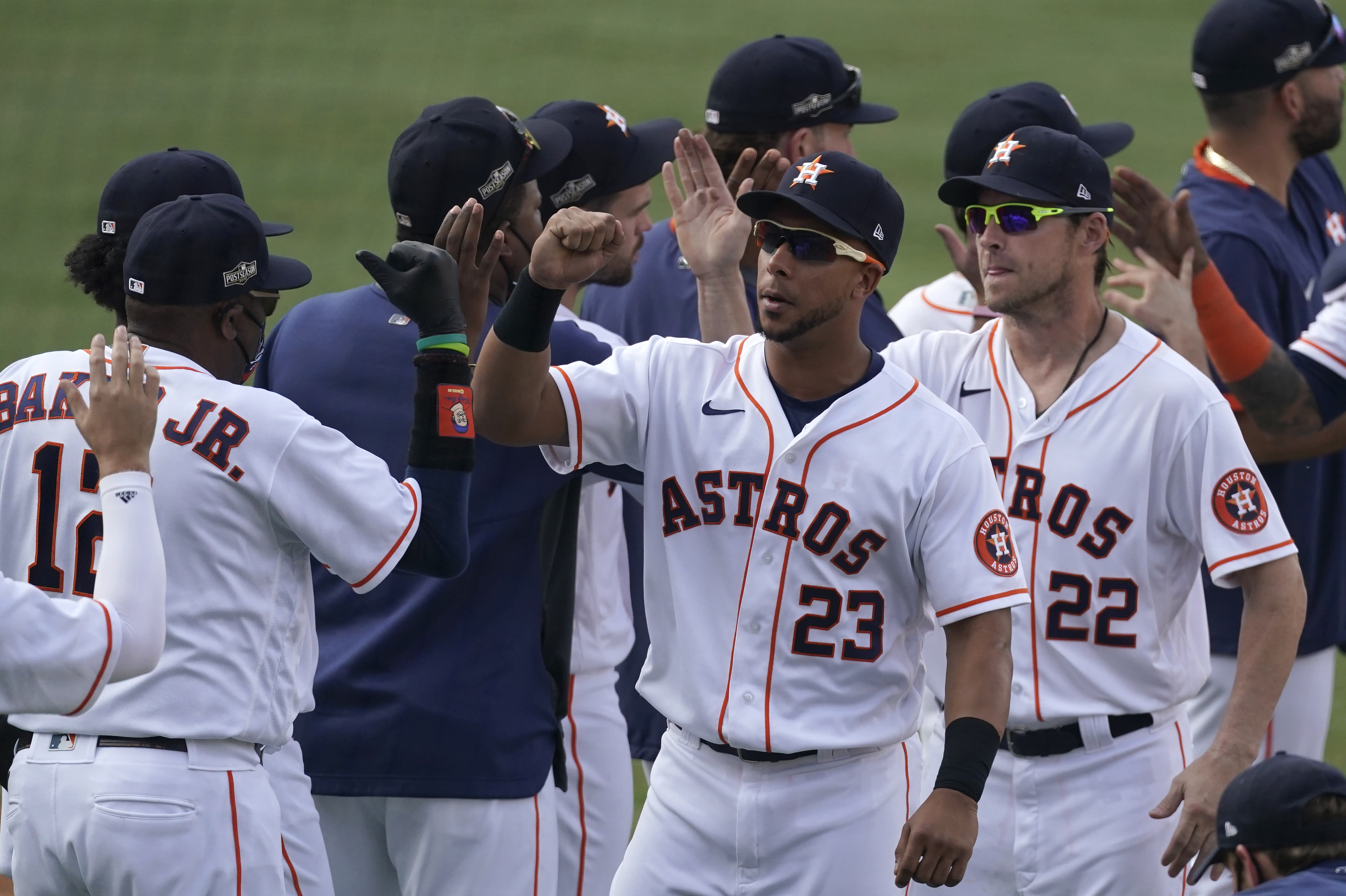 Houston Astros manager Dusty Baker Jr., left, celebrates with Michael Brantley (23), Josh Reddick (22) and others after the Astros defeated the Oakland Athletics in Game 4 of a baseball American League Division Series in Los Angeles, Thursday, Oct. 8, 2020. (AP Photo/Ashley Landis)