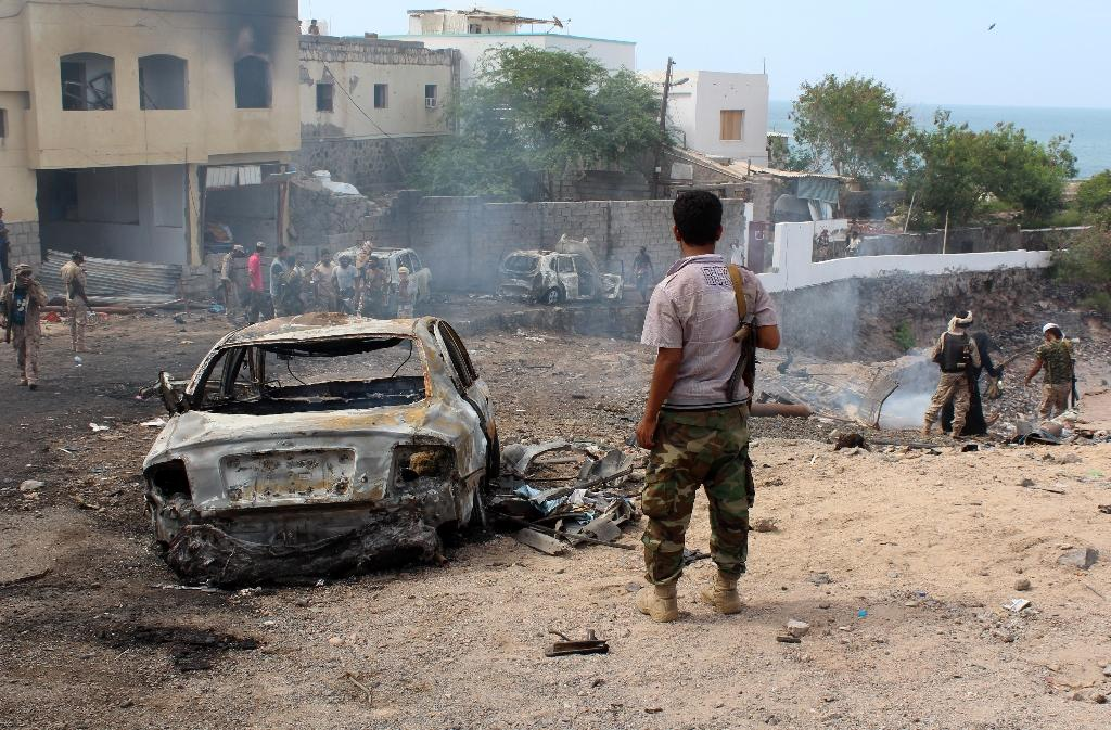 Yemeni loyalist forces and onlookers gather at the scene of a suicide attack targeting the police chief in the base of the Saudi-backed government on April 28, 2016 in Aden (AFP Photo/Saleh al-Obeidi)