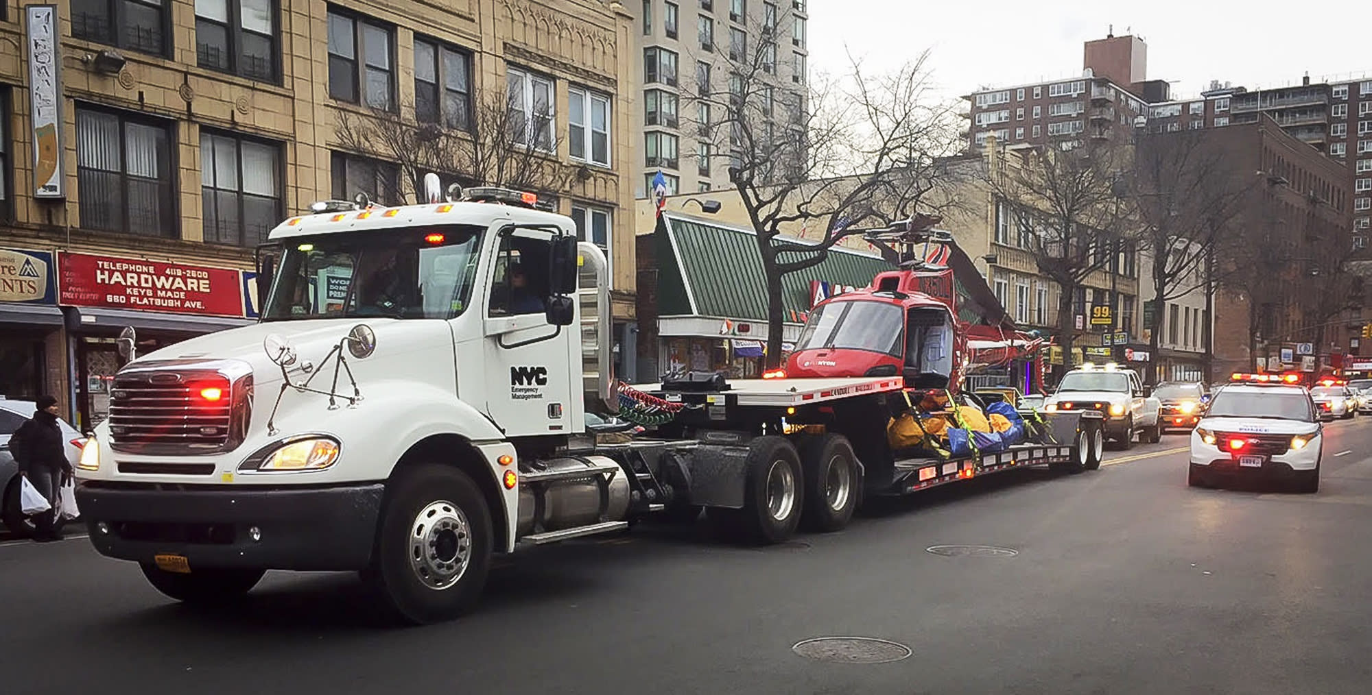 <p>A helicopter that crashed in New York's East River killing five passengers is carried on a trailer truck with a police escort, along Flatbush Avenue in Brooklyn Borough of New York, March 12, 2018. (Photo: Bebeto Matthews/AP) </p>