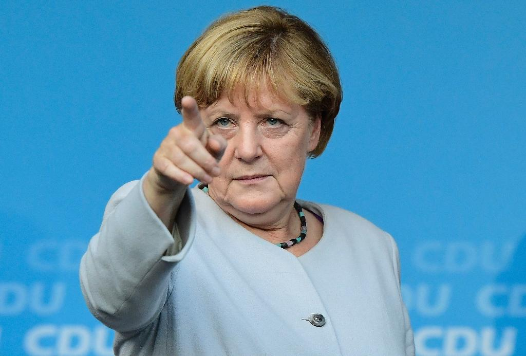When German Chancellor Angela Merkel's centre-right Christian Democratic Union holds its annual congress she will seek to rally members behind her bid for a 4th term (AFP Photo/TOBIAS SCHWARZ)