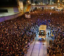 Hong Kong leader apologises as rally chokes city