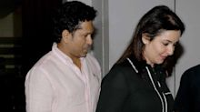 Spotted: Sachin and Anjali Tendulkar pose for shutterbugs after dinner date