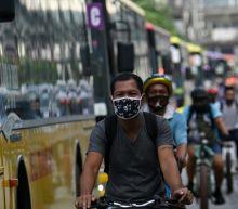 Philippine capital reopens despite jump in virus cases