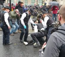 """Police in central London wrestle BLM protester to ground after he """"kicked out at officer"""""""