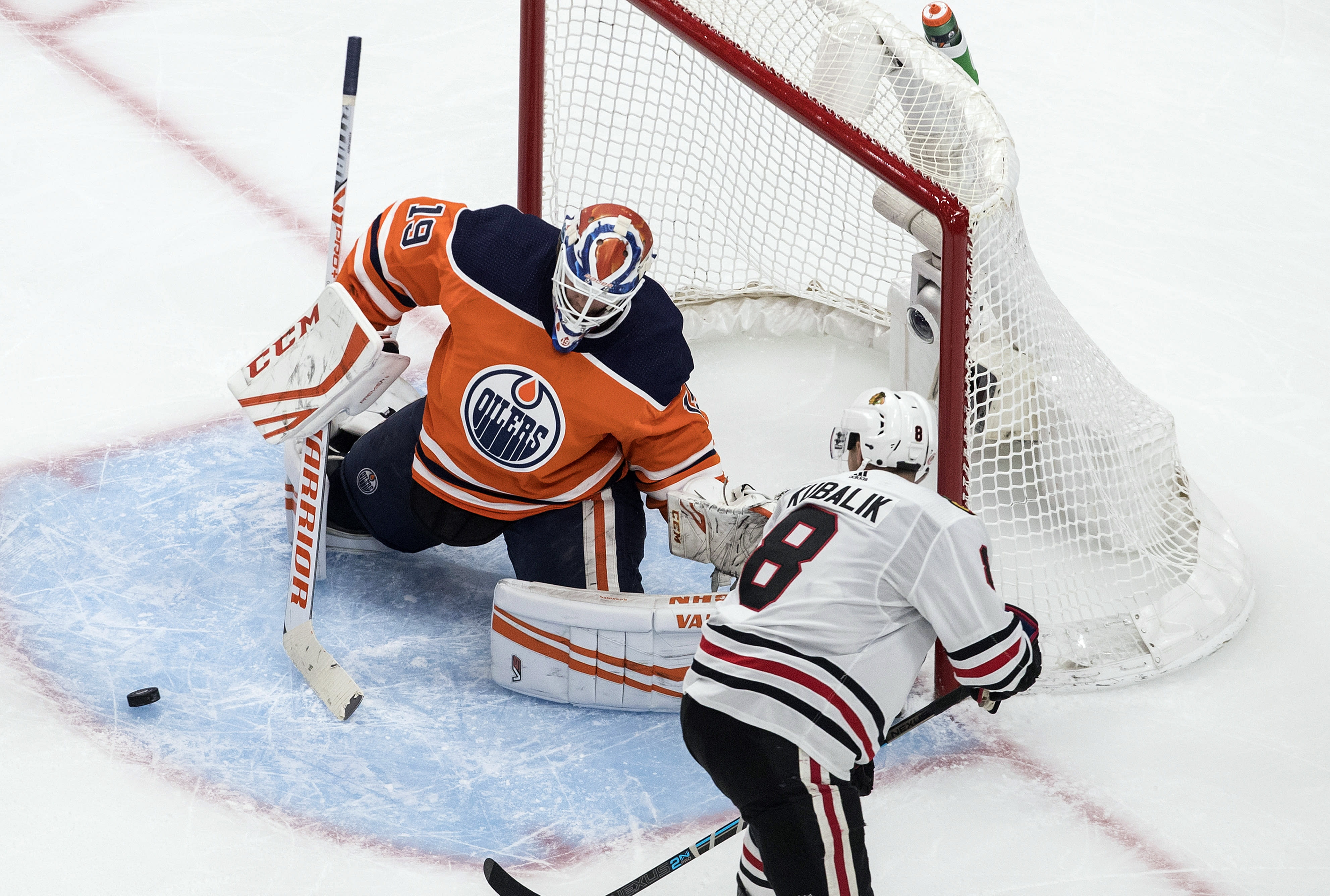 Edmonton Oilers goalie Mikko Koskinen (19) makes a save against Chicago Blackhawks' Dominik Kubalik (8) during third-period NHL hockey Stanley Cup playoff game action in Edmonton, Alberta, Saturday, Aug. 1, 2020. (Jason Franson/The Canadian Press via AP)
