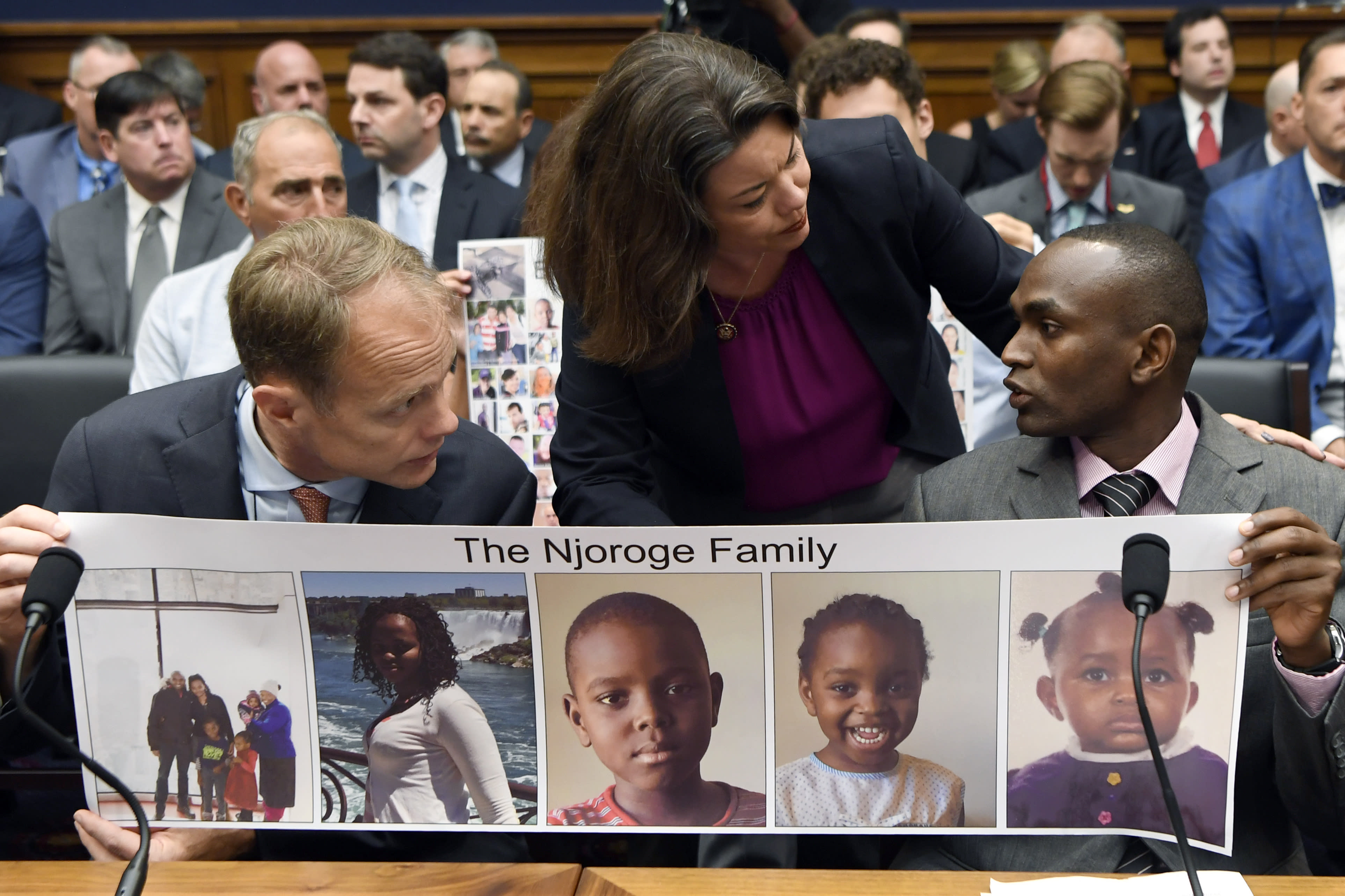 Rep. Angela Craig, D-Minn., center, talks with Paul Njoroge, right, as Michael Stumo, left, looks on before the start of a House Transportation subcommittee hearing on Capitol Hill in Washington, Wednesday, July 17, 2019, on aviation safety. Njoroge lost his wife and three young children on Ethiopian Airlines Flight 302 and Stumo lost his daughter on the same flight. The plane was a Boeing 737 MAX. (AP Photo/Susan Walsh)