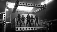Pussycat Dolls dripping wet in skintight PVC in raunchy comeback video