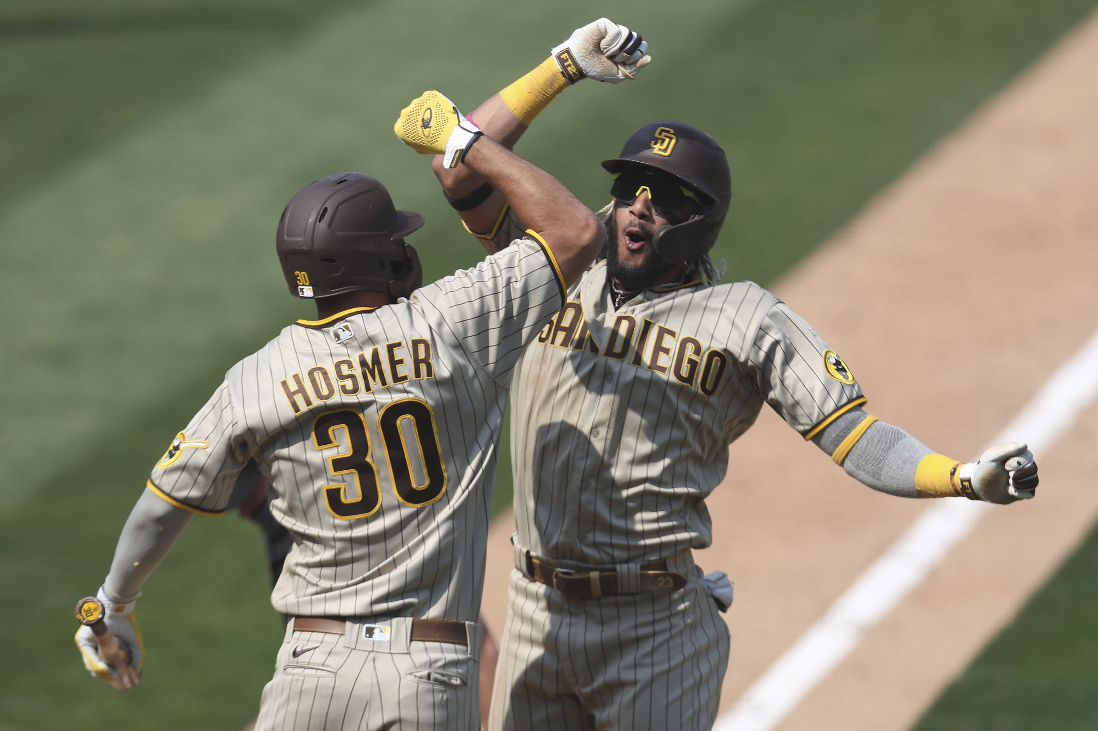 San Diego Padres' Fernando Tatis Jr celebrates after hitting a solo home run against the Oakland Athletics with teammate Eric Hosmer during the seventh inning of a baseball game in Oakland, Calif., Sunday, Sept. 6, 2020. (AP Photo/Jed Jacobsohn)