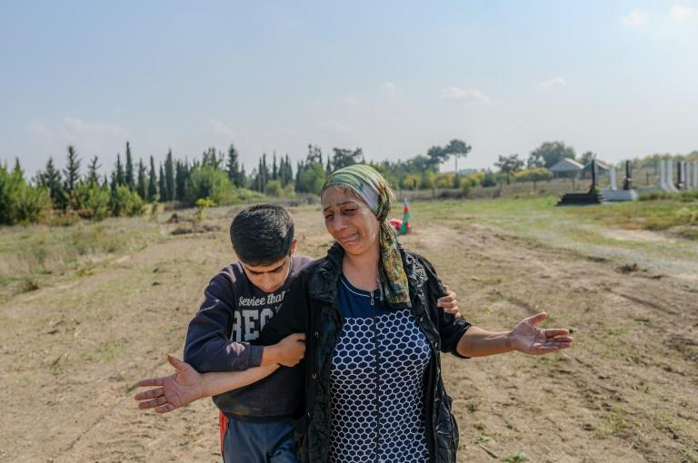 Aybeniz Khasanova cries next to the grave of her son, who died in fighting over Nagorno-Karabakh
