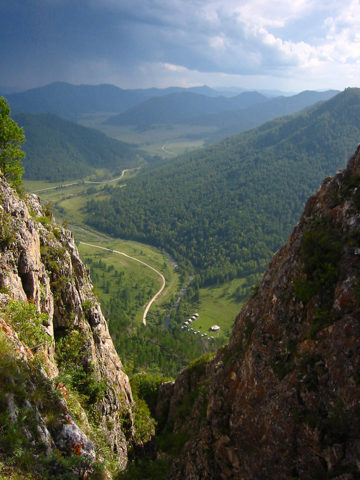 This undated photo provided by Bence Viola of the University of Toronto in August 2018 shows the valley above a cave where Denisovan fossils were found in the Altai Krai area of Russia. On Wednesday, Aug. 22, 2018, scientists reported in the journal Nature that they have found the remains of an ancient female whose mother was a Neanderthal and whose father belonged to another extinct group of human relatives known as Denisovans. (Bence Viola/Department of Anthropology - University of Toronto/Max Planck Institute for Evolutionary Anthropology via AP)