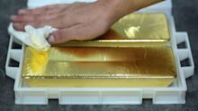 Gold Declines as Dollar Strengthens Ahead of Powell Testimony