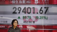 Asian shares gain as Fed says it will hold off on rate hikes