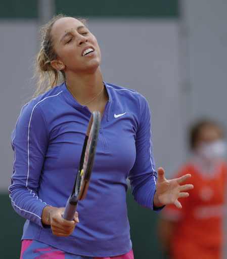 Madison Keys of the U.S. reacts after missing a shot against China's Zhang Shuai in the first round match of the French Open tennis tournament at the Roland Garros stadium in Paris, France, Monday, Sept. 28, 2020. (AP Photo/Christophe Ena)