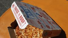 Domino's climbs despite earnings and revenue miss