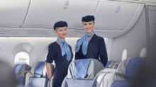 The real reason flight attendants greet you with their hands behind their back