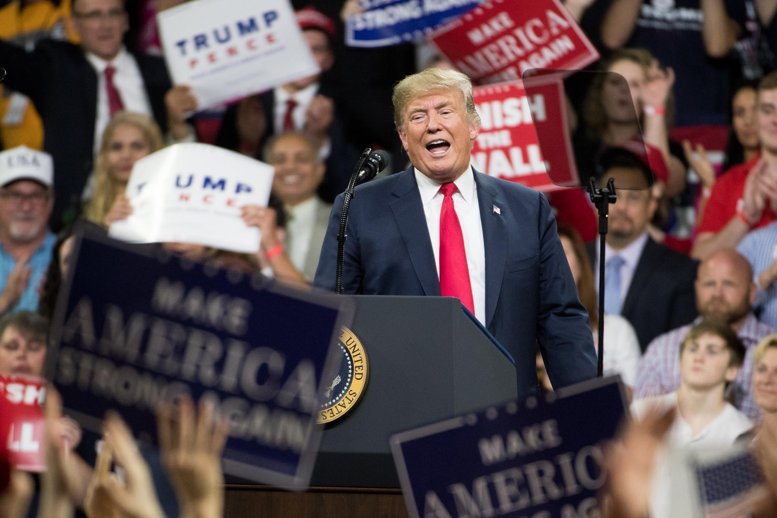 Trump campaign, in strategy shift, makes push in early-voting states
