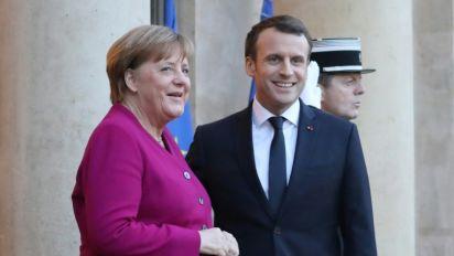 Macron boosts Merkel ahead of key coalition vote