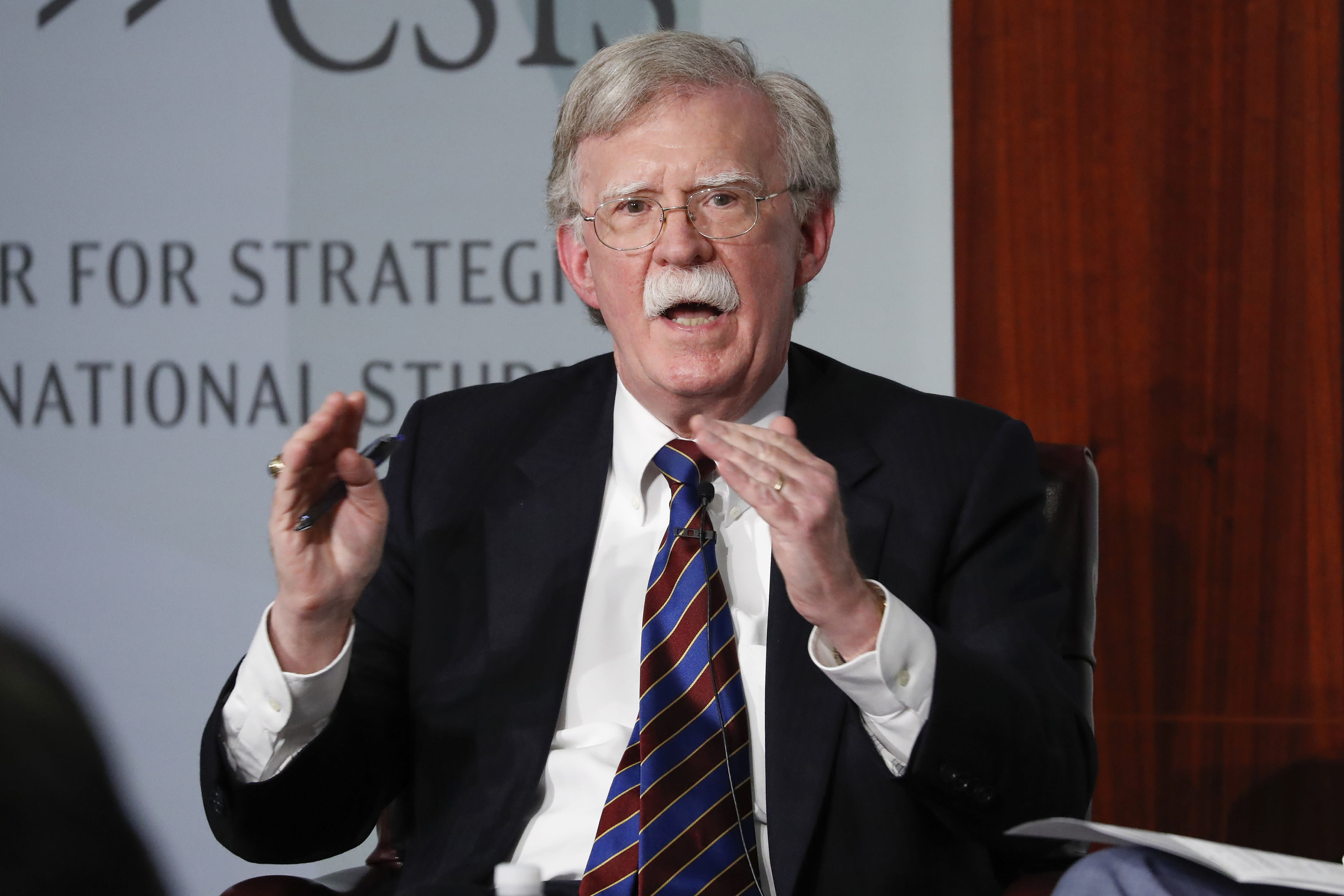 FILE - In this Sept. 30, 2019, file photo, former national security adviser John Bolton gestures while speakings at the Center for Strategic and International Studies in Washington. They are the ghosts of the House impeachment hearings. Vice President Mike Pence. Secretary of State Mike Pompeo. Energy Secretary Rick Perry. Acting White House Chief of Staff Mick Mulvaney. And perhaps most tantalizingly, the mustachioed John Bolton, President Donald Trump's former national security adviser. (AP Photo/Pablo Martinez Monsivais, File)