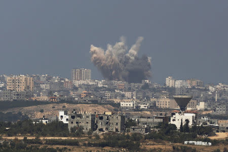 Smoke rises in the Gaza Strip after an Israeli strike August 8, 2014. REUTERS/Amir Cohen