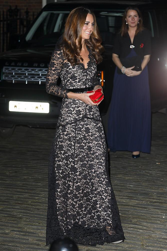 Kate dons her lace Temperley London gown once more, this time adding a pop of red with her Alexander McQueen clutch.