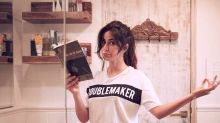 This picture of Katrina Kaif trying to find her inner peace whilst multitasking is endearing
