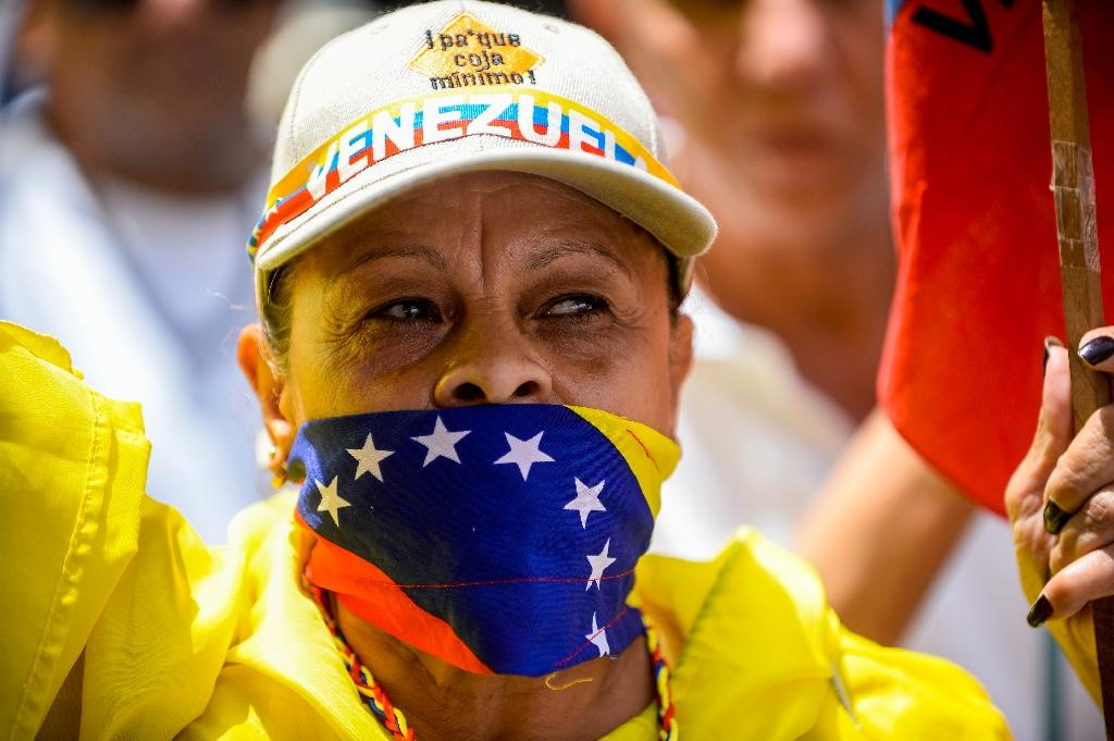 A Venezuelan opposition activist takes part in a peaceful demonstration in Caracas, on June 20, 2015