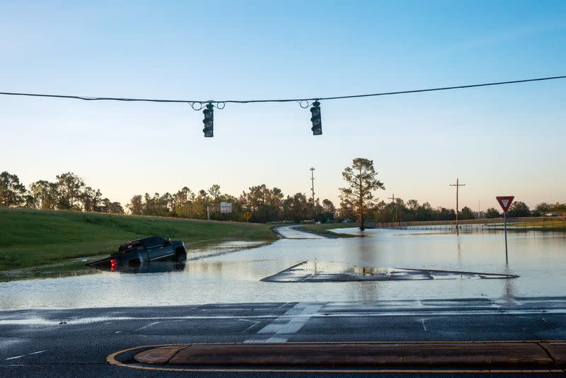 A submerged car is pictured on a flooded street after Hurricane Delta in Lake Charles
