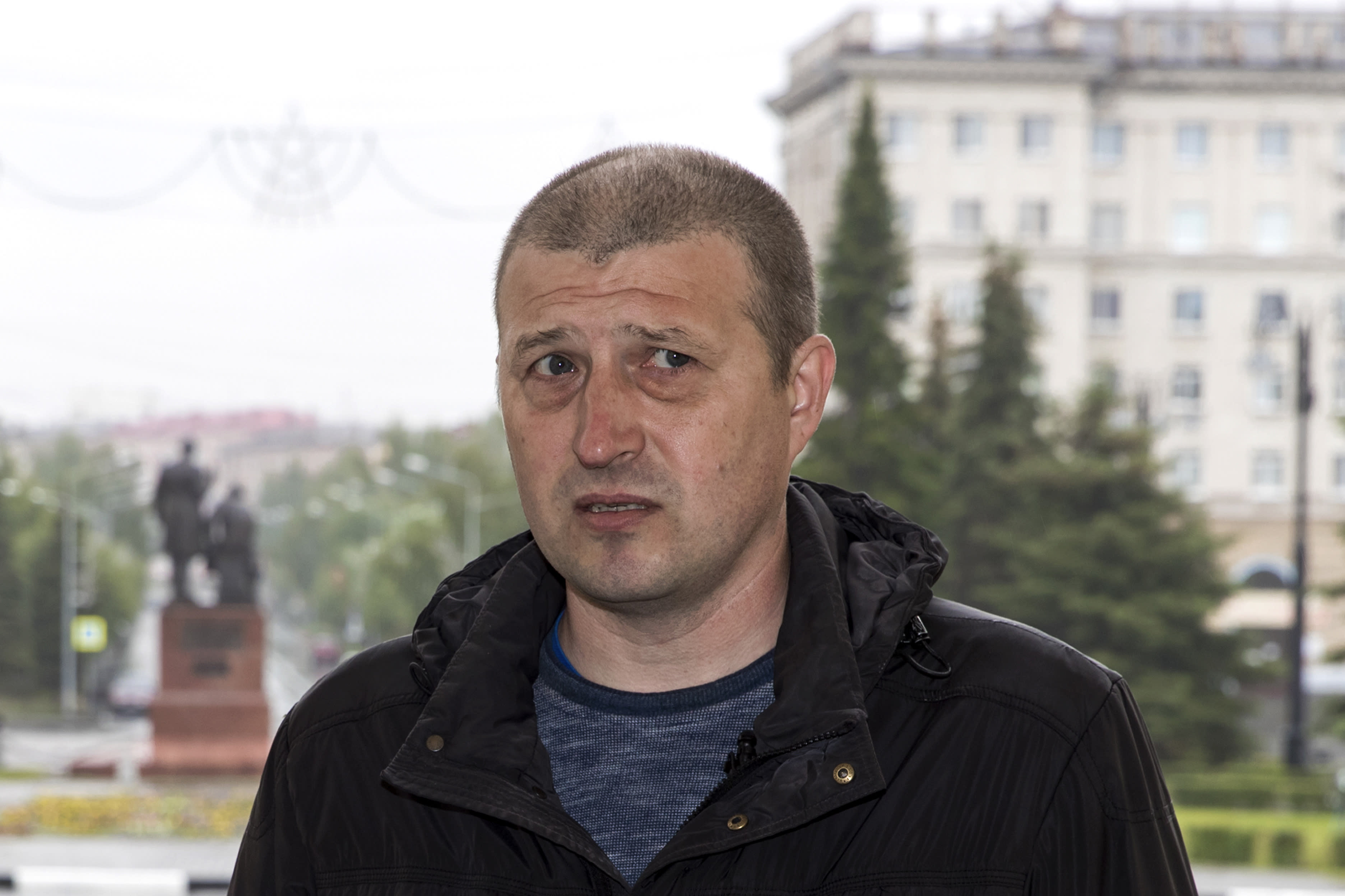 """In this photo taken on Sunday, June 28, 2020, Nikolay Nemytov, a 43-year-old engineer at Russian Railways, speaks during an interview with The Associated Press in Nizhny Tagil, some 1,400 kilometers (870 miles) east of Moscow, Russia. Workers in the city that once was seen as a Putin stronghold are speaking out against the constitutional reforms that would allow him to stay in office until 2036 amid growing frustration over their dire living conditions that have not improved. """"I am against the constitutional changes, most importantly because they are a coronation of the czar, who reigns but does not rule — Vladimir Vladimirovich Putin,"""" says Nemytov. He says his monthly salary, the equivalent of $430, is not nearly enough. (AP Photo/Anton Basanayev)"""