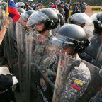 Humanitarian aid trucks crossing into Venezuela 'incinerated,' military defections grow