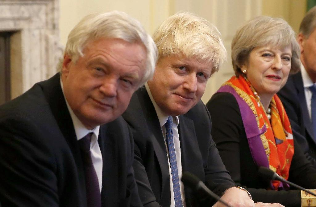 David Davis, left, quit as Brexit minister on Sunday, then Boris Johnson, centre, resigned on Monday. British PM Theresa May, right, quickly replaced them (AFP Photo/PETER NICHOLLS)
