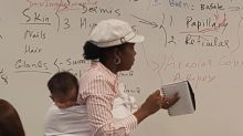 Professor holds baby during 3-hour class after student couldn't find a sitter