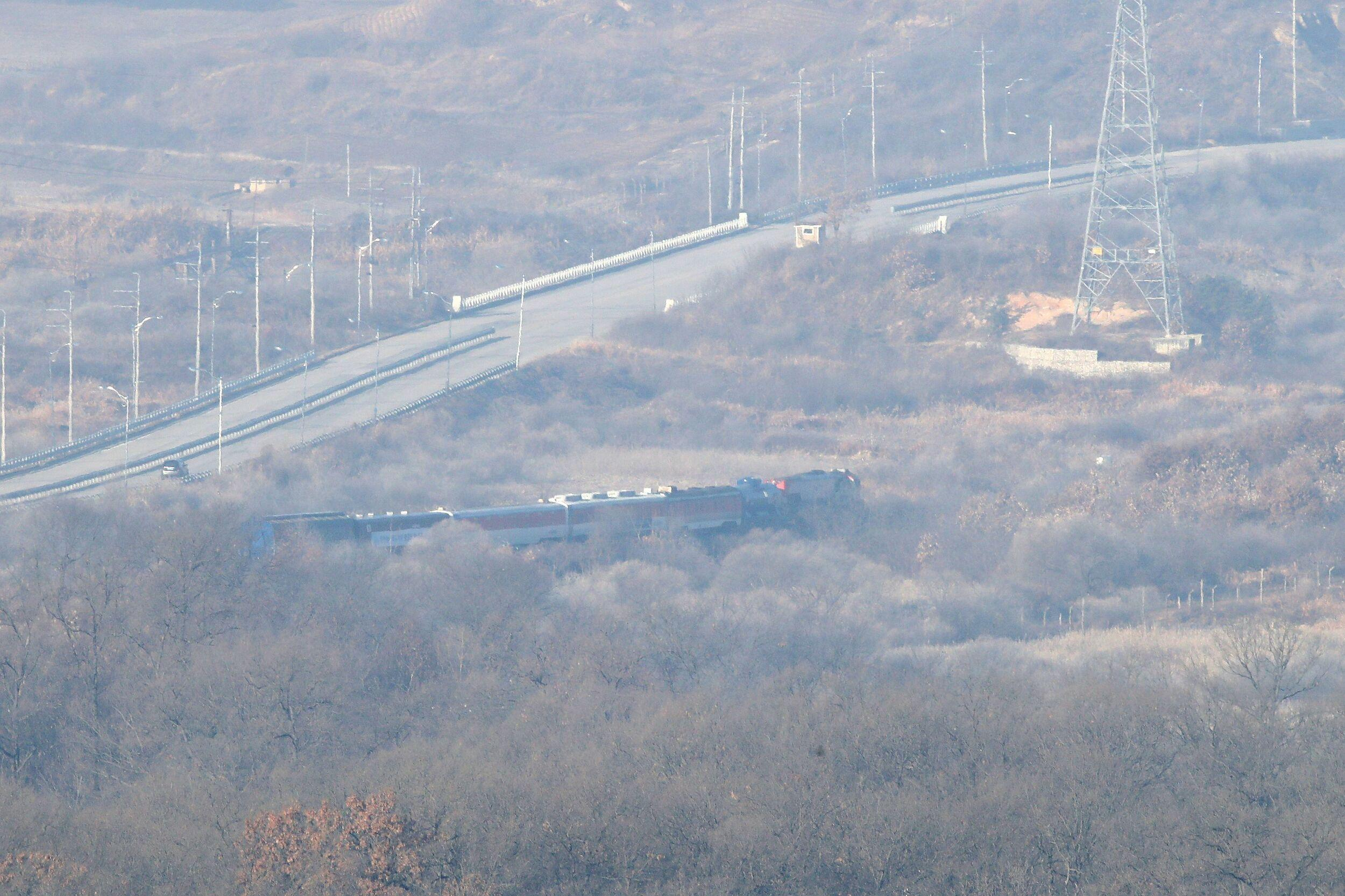 A South Korean train trainsporting dozens of South Korean officials runs on the rails which leads to North Korea, inside the demilitarized zone separating the two Koreas in Paju, on November 30, 2018. - A train carrying South Korean engineers and officials crossed the border into North Korea for a joint survey with North Koreans for reconnecting the two Koreas with railways. (Photo by Chung Sung-Jun / POOL / AFP)        (Photo credit should read CHUNG SUNG-JUN/AFP/Getty Images)