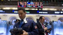 Futures point to a flat open on Wall Street, amid more earnings, data releases