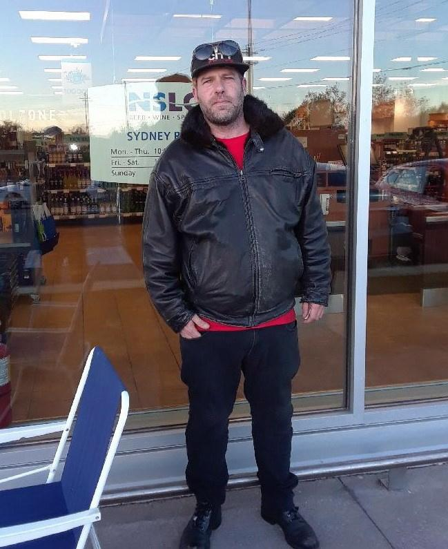 <p>Canadian musician Ashley MacIsaac stands outside the Nova Scotia Liquor Corporation's cannabis store in Sydney River, N.S. on Wednesday, October 17, 2018. MacIsaac was among the first people to legally buy weed.<br>(Photo from The Canadian Press) </p>