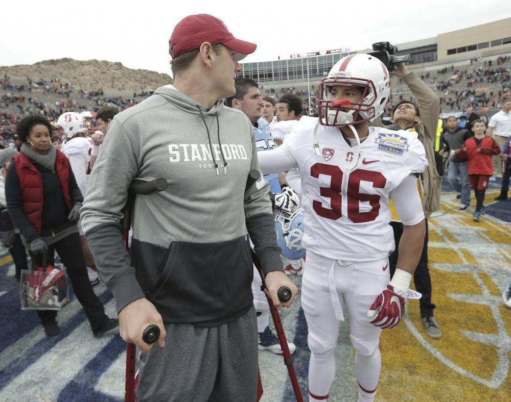 Stanford quarterback Keller Chryst. left, was injured in the Sun Bowl. (AP Photo/Mark Lambie)