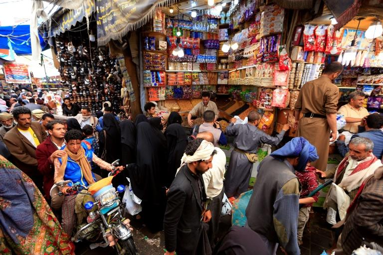 Yemenis celebrating the Muslim holiday of Eid al-Adha buy sweets and nuts at a market in the capital Sanaa, where Huthi rebel authorities freed members of the Baha'i community