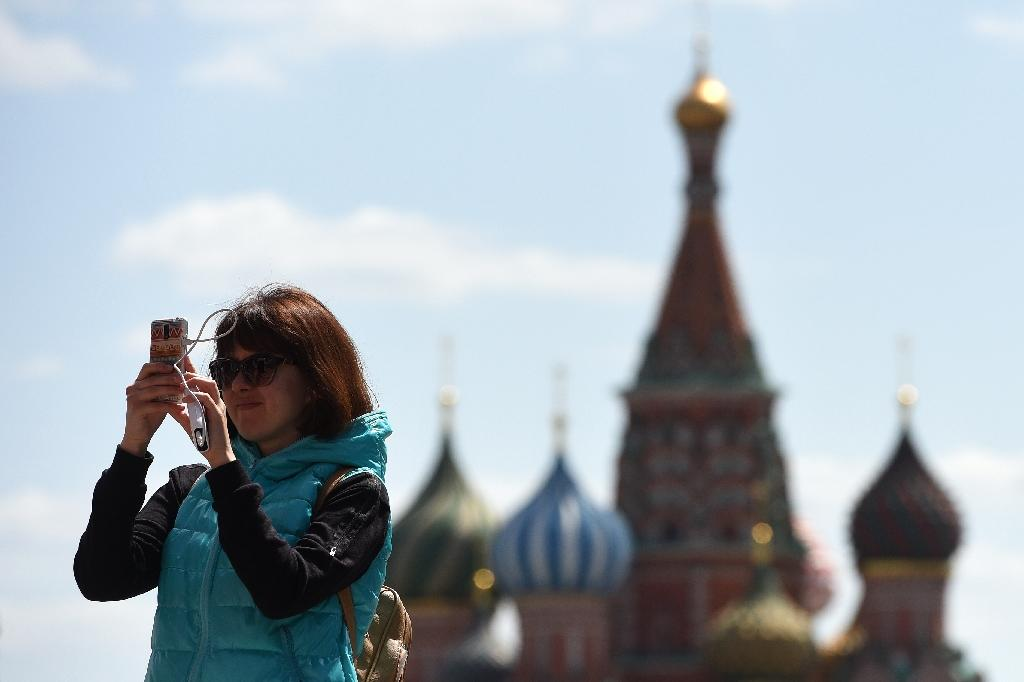 Russian authorities and members of the public have lashed out at recent inventions such as a phone call interception system and a face recognition app as breached of law or infringement of privacy (AFP Photo/Vasily Maximov)
