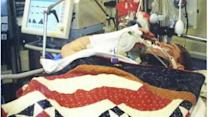 Injured soldier salutes as he receives Purple Heart