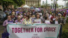 Abortion decriminalised in Queensland in historic vote