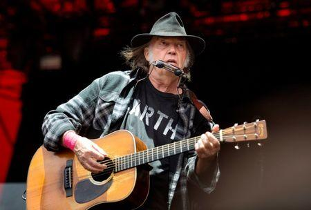 Canadian singer-songwriter Neil Young performs at the Orange Stage at the Roskilde Festival in Roskilde, Denmark, July 1, 2016. Picture taken July 1, 2016. Scanpix Denmark/Nils Meilvang/via REUTERS