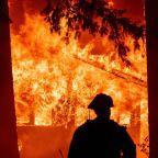 California's largest wildfire razes homes as 88 huge blazes rage in U.S.
