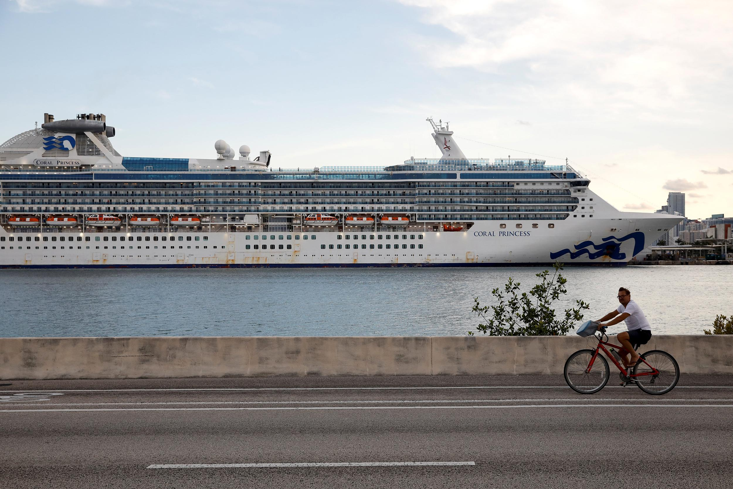 Thousands of cruise ship crew members remain out at sea